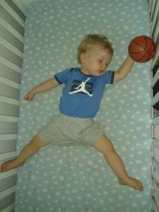 Found my 17 month old baby sleeping in the exact same position as the Michael Jordan symbol on his bodysuit!  I couldn't resist putting a baby basketball in his hand for a photo!