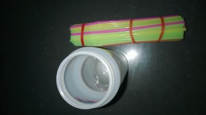 Bind the straws together and find a tall cup/jug/vessel that is the same height and circumference as your straw bundle.