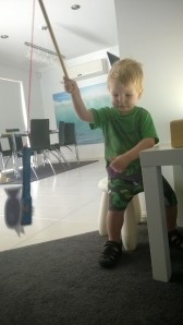 Our fishing rod was made from a piece of wooden dowling, some wool attached with sticky tape tied on to a magnet wand!  My 2 year old found it fun just to simply dangle the fish around on the fishing rod!!  xx