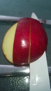 You should then have an apple with one tall red line going down the middle and two cut sides, so if you look from the front it kind of looks like an upside down T.