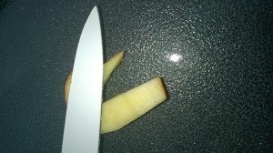 Squash the apple seed down in to the apple using the side of your knife.  Then repeat this on the other side of the face with the other apple seed.
